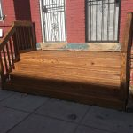Washington, DC residential wood front porch with final stain coats applied